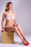 Pin up girl with cherry. Pin up girl in swimsuit and red shoes holding cherry Stock Image