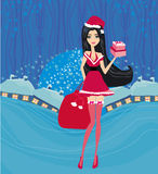 Pin-up girl in Christmas inspired costume card Stock Photo