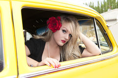 Pin Up Girl and Classic Car. Sexy blonde pin up girl sitting inside classic car Royalty Free Stock Photography