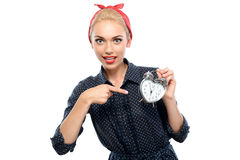 Pin up girl with a clock Royalty Free Stock Photo