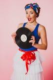 Pin Up Girl con el expediente del disco Foto de archivo libre de regalías