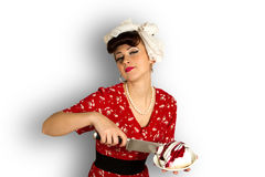 Pin up girl cuts cake Stock Photo
