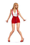 Pin-up-Girl in den roten Kurzschlüssen Stockfotografie
