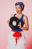 Pin Up Girl with disc record Royalty Free Stock Photo