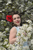 Pin up girl with a dogwood tree in the spring Stock Images