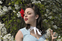 Pin up girl with a dogwood tree in the spring Stock Image