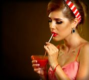 Pin up girl drink bloody Mary cocktail. Pin-up retro female style. Royalty Free Stock Images