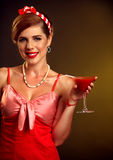 Pin up girl drink bloody Mary cocktail . Pin-up retro female style. Stock Image