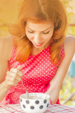 Pin-up girl eating ice cream, retro style imagery Royalty Free Stock Photography