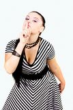 Pin up girl with finger at her lips Stock Photography