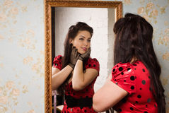 Pin-up girl in front of the mirror. Attractive pin-up girl in front of the mirror stock image