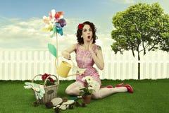 Pin up girl gardening stock photos