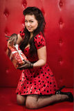 Pin-up girl with gift. Happy pin-up girl with gift Royalty Free Stock Photos