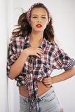 Pin-up girl with gingham headband Royalty Free Stock Image