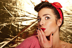 Pin-up girl on gold background Royalty Free Stock Photos
