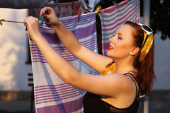 Pin up girl hanging the laundry Royalty Free Stock Photo