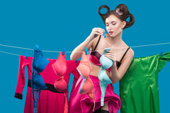 Pin-up girl hangs bras Royalty Free Stock Photography