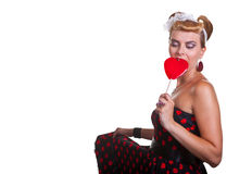 Pin-up Girl with heart shaped candy Royalty Free Stock Photos