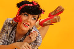 Pin up girl with heart shaped lollipop Stock Photography
