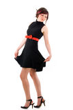 Pin-up girl on a high heels. Isolated pin-up girl on a high heels walking in black dress Stock Photography
