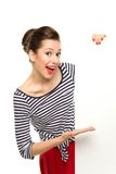 Pin-up girl holding blank poster Royalty Free Stock Image