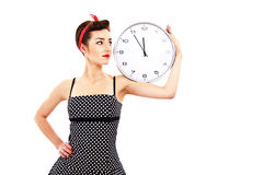 Pin-up girl holding clock Stock Photography