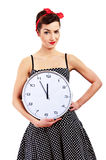 Pin-up girl holding clock Royalty Free Stock Photography