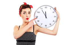 Pin-up girl holding clock Royalty Free Stock Images