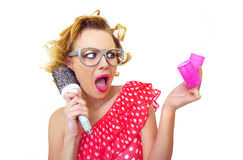 Pin-Up Girl holding curlers Stock Images