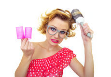 Pin-Up Girl holding curlers Stock Photography
