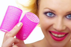 Pin-Up Girl holding curlers Stock Photo