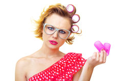 Pin-Up Girl holding curlers Royalty Free Stock Photography