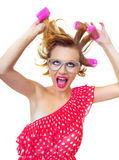 Pin-Up Girl holding curlers Royalty Free Stock Image
