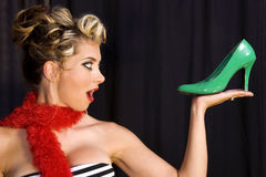 Pin-up girl holding green stil Stock Photography