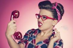 Pin up girl. Irritated smoking pin-up girl with retro telephone Royalty Free Stock Photo