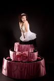 Pin-up girl jumping toy cake Royalty Free Stock Photography