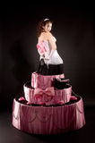 Pin-up girl jumping toy cake. Pin-up girl in a white corset and tulle skirt with a jumping toy cake Stock Photography