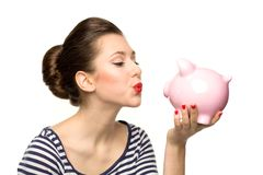 Pin-up girl kissing piggybank Royalty Free Stock Photo