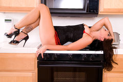 Pin-up girl in kitchen. Stock Photography