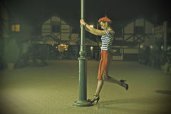 Pin Up Girl and lantern. Pin up girls in a Parisian style, outside at night, retro stylized photo Royalty Free Stock Photos