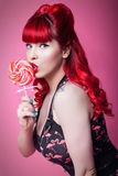 Pin-up girl with lollipop. Young sexy girl, 50s style, posing with lollipop Stock Image
