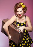 Pin-up girl with luggage Stock Images
