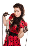 Pin-up girl with a microphone cord Royalty Free Stock Image