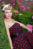 Pin-up girl outdoor in the garden Stock Images