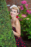 Pin-up girl outdoor in the garden Stock Photos