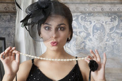Pin up girl with pearl necklace Stock Photo