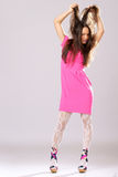 Pin-up girl in pink dress Stock Photography