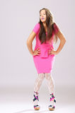 Pin-up girl in pink dress Stock Photo