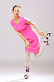 Pin-up girl in pink dress Stock Photos