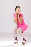 Pin-up girl in pink dress Stock Photos